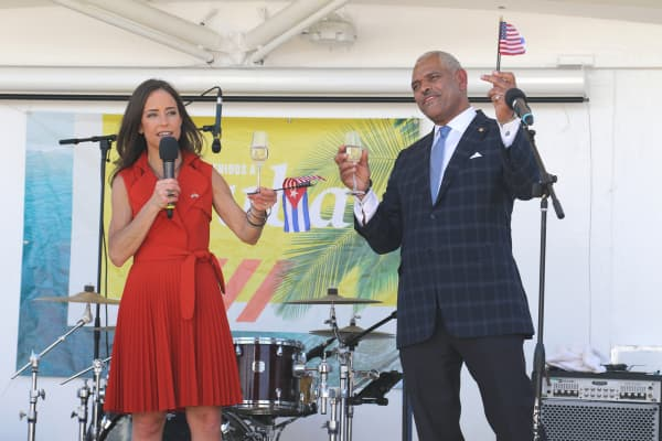 Carnival Corporation's CEO and President Arnold Donald and Fathom President Tara Russell toast the passengers, the crew and the historic voyage as Carnival's Adonia pulled away from Miami, Florida on its way to Cuba.